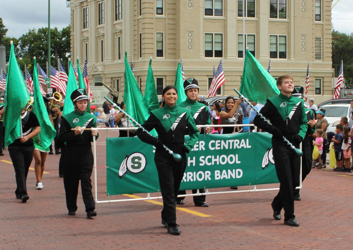 Drum Majors, Pammela Garcia and Kasey Brabec, lead the band in the Schuyler Labor Day Parade.
