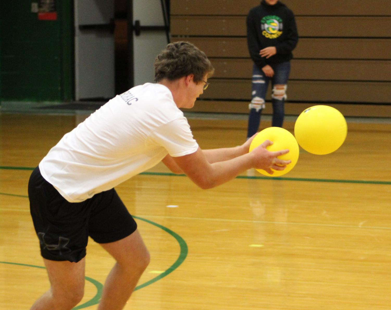 Teams of students dodge for a good cause.