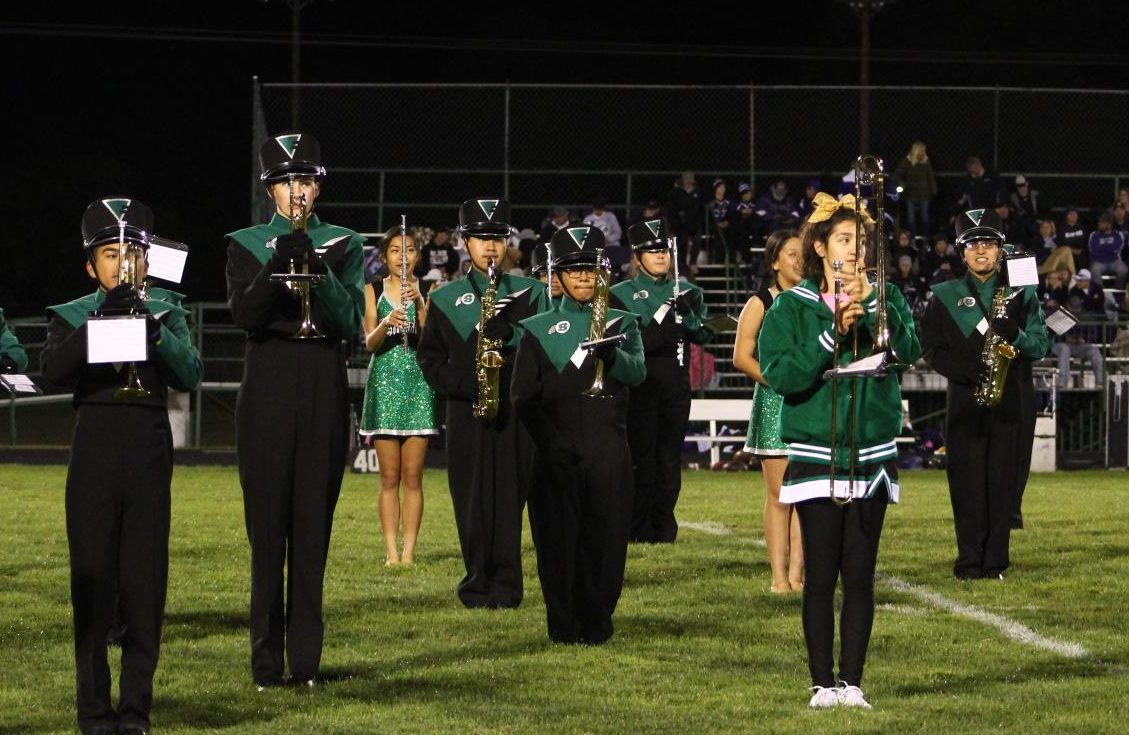 The Schuyler Marching Band performing during halftime at a football game. Photo Credits: Yearbook Staff