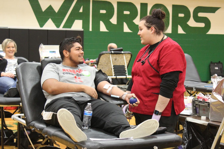 Senior Kevin Rodriguez donating blood.