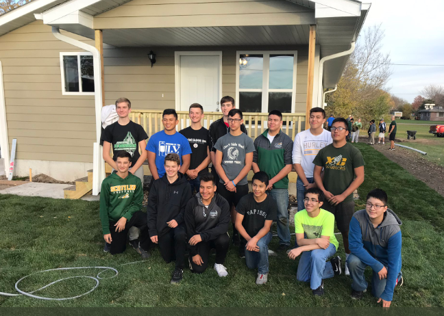 Boys+basketball+team+at+the+Habitat+for+Humanity+house.