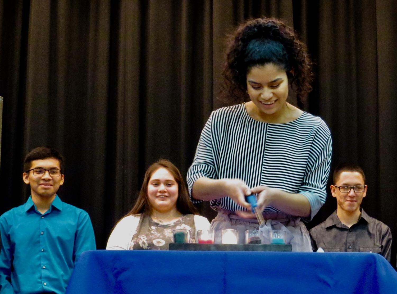 Nayeli Cruz assisting  with the National Honor Society Induction Ceremony.