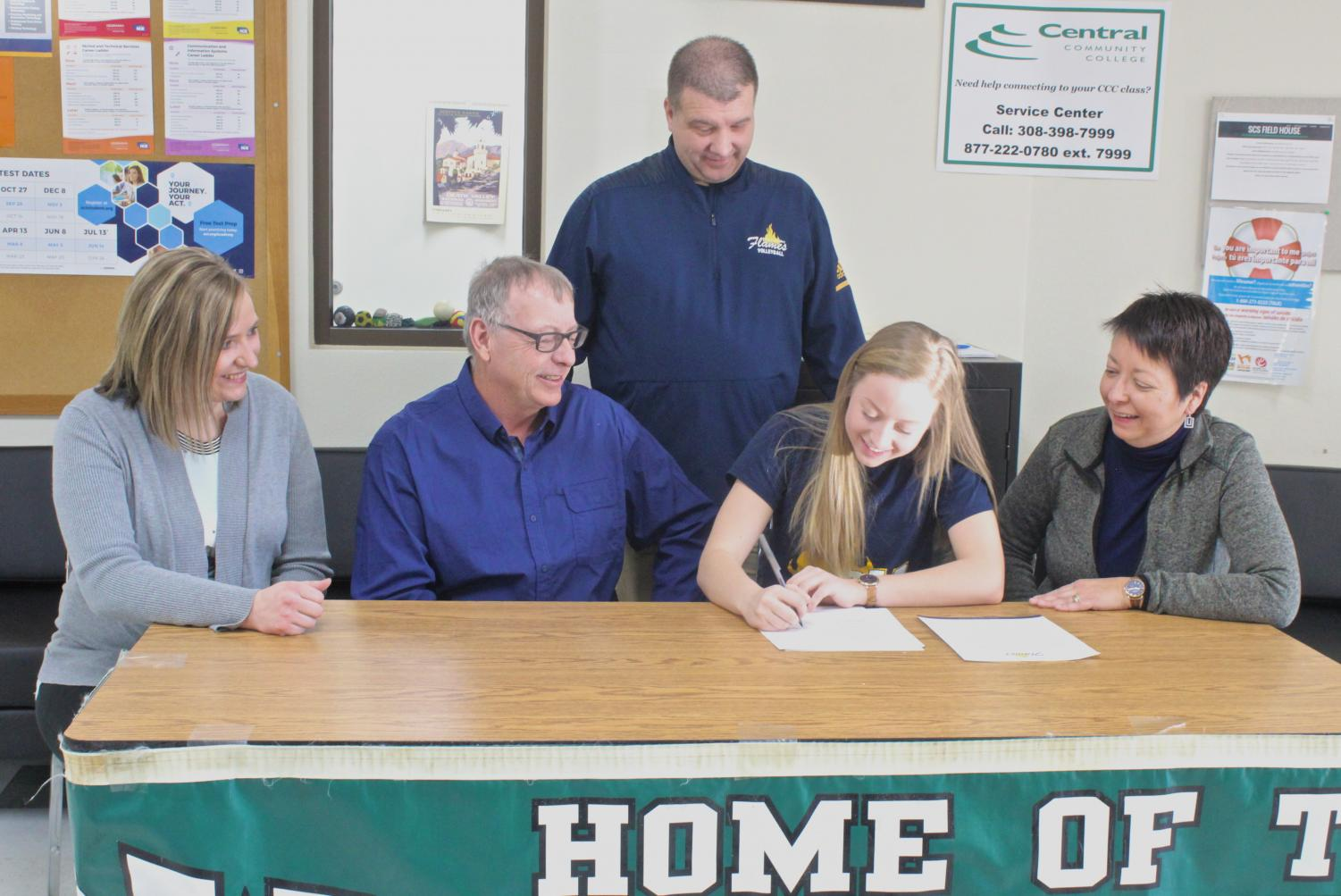 Maria Semarad signs the contract to play for St. Mary's College.
