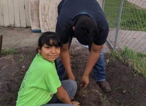 Bryan and Yareli Romero help plant trees with the SCS Warriors Academy program.