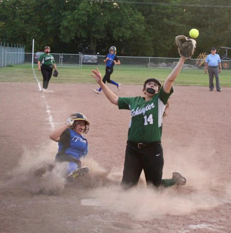 Pitcher, Lucy Mendez, fights time to get runner out.