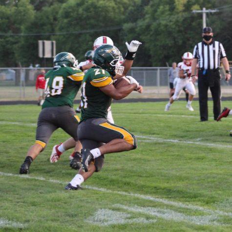 Warrior runs to gain distance on the field.