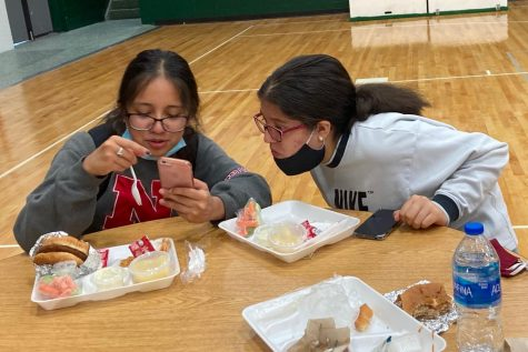 Freshmen, Yuleika Sanchez and Yanibeth Carias, enjoying their lunch together.