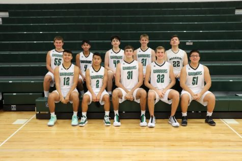 SCHS Boys Basketball team poses for picture on the bleachers.