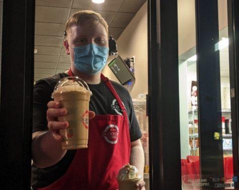 SCHS student, Vincent Wegner giving a customer a drink.