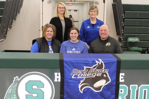 Carly Johnson and parents pose for picture with her high school golf coach, Shanda Hall and Peru State College coach.