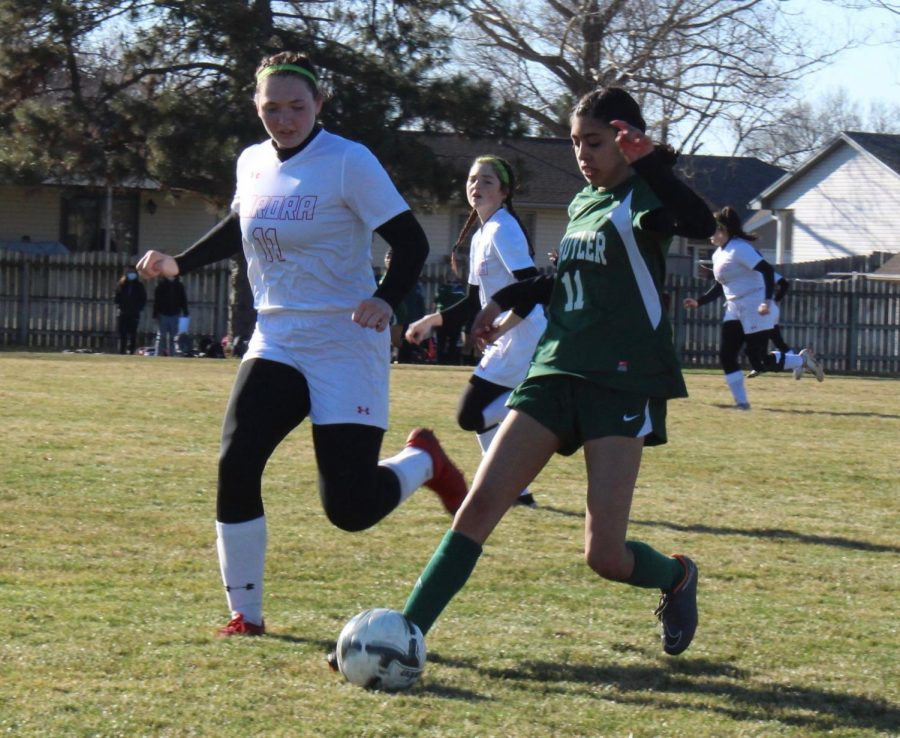 Ailyn Adame controlling the soccer ball.