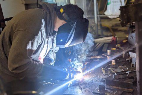 FFA Member woking hard on welding work.