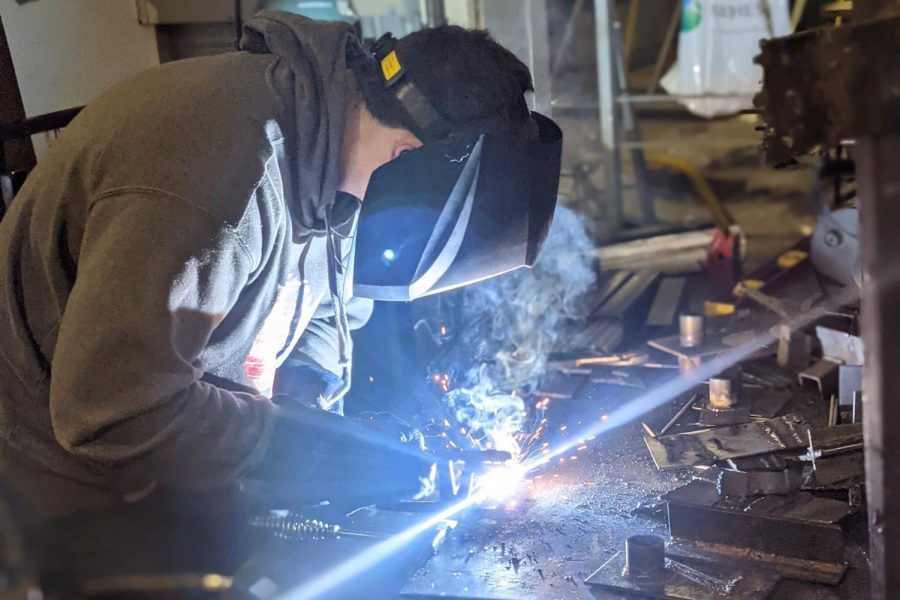 FFA+Member+woking+hard+on+welding+work.