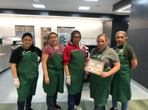 SCHS food service staff poses for picture in front of the SCHS kitchen.